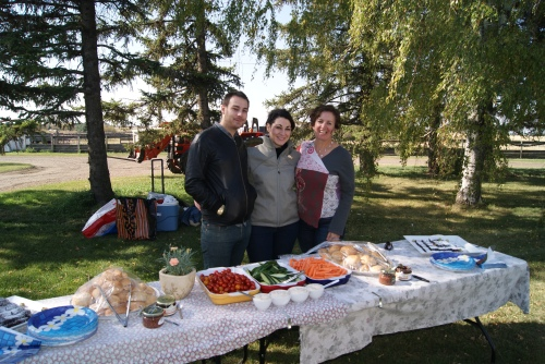 "We love to take guests to Alberta farms to ""Taste this place"" Here I am with Matt & Tilly at Winter's Turkey Farm  Photo credit - Karen Anderson"