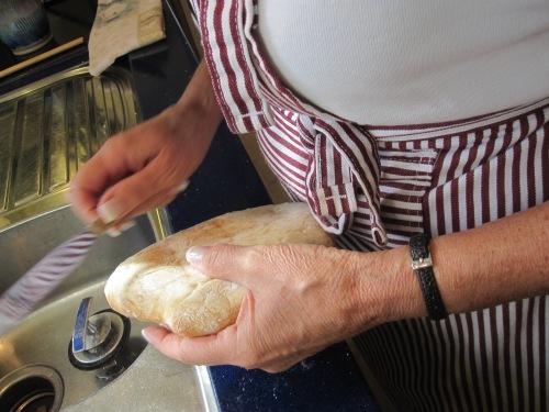 scrape the bottom to remove extra flour