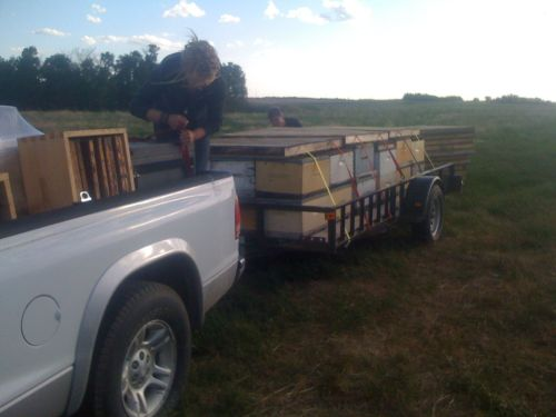 Eliese Watson of Bees for communities loading my bees in Saskatchewan for the trip to Calgary