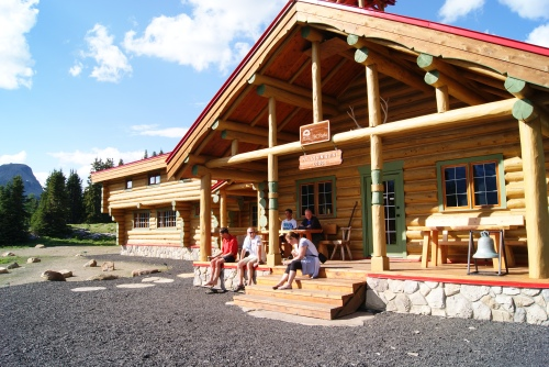 relaxing with a cool drink on the porch of Mt. Assiniboine Lodge photo - Karen Anderson