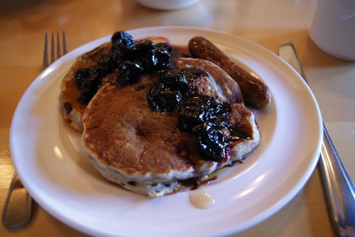 pancakes with warm cherry compote and sausages at Mt. Assiniboine Lodge photo - Karen Anderson