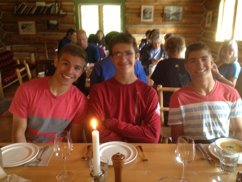 Happy hikers with very healthy appetites grateful that dinner is served at Mt. Assiniboine Lodge photo - Karen Anderson
