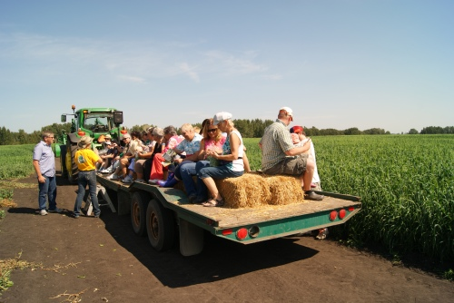 Elna Edgar pulled 30 of us out to the field in this cushy wagon she hooked up to her tractor - that was fun photo - Karen Anderson
