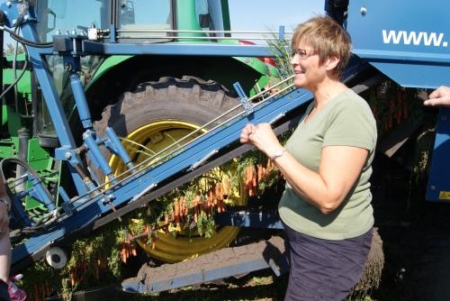 Shelley Bradshaw with her carrot harvesting machine photo - Karen Anderson