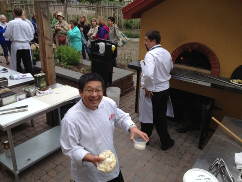 From the table to the huge al forno oven  - a lesson in pizza with the masters chef Kat Mori with simply delicious toppings at SAIT culinary garden photo - Karen Anderson