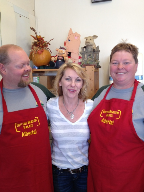 Alberta pork producers Greg and Bonnie Spragg were featured on the PBS show Off The Beaten Palate and are seen here with host Michael-Ann Rowe (centre) photo - Karen Anderson