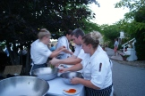 The team in motion - plating al fresco Photo - Karen Anderson