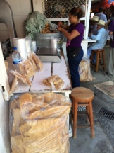 a whole stall of pork crackling photo - Karen Anderson