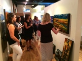 Gibson Fine Art gallery owner Patti Dibski shares art approachability with our guests photo - Karen Anderson