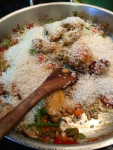 add the rice and stir it until it is coated photo - Karen Anderson
