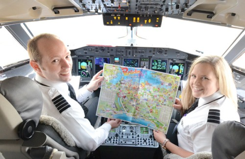 Capt. Jaren Belrose and first officer Shauna Epp on the flight deck of the WestJet Q400 look over a map of Penticton on the ground at Kelowna International Airport Thursday while waiting for passengers to start boarding. The same type of aircraft will be used in the direct service between Penticton and Calgary, Alta. which begins Sunday -  photo credit  - Mark Brett/Western News