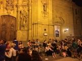 Saturday night on the steps of Santa Maria - pintxos people - photo - Karen Anderson