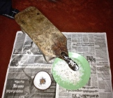 coconut grater in use - photo - Karen Anderson