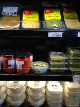 Mrs Traya's hummus and baba ghanoush are on sale at her son's store - photo - Karen Anderson