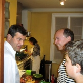 visiting in the kitchen with our friends Veronique and Michael as she finishes the main course - photo - Karen Anderson