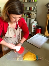 fill a pastry bag with the choux pastry dough - photo - Karen Anderson