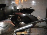 Wok and roll - woks in a restaurant in Lijiang, China - photo credit - Karen Anderson