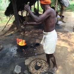 Man roasting cashews - photo credit - Karen Anderson @savouritall