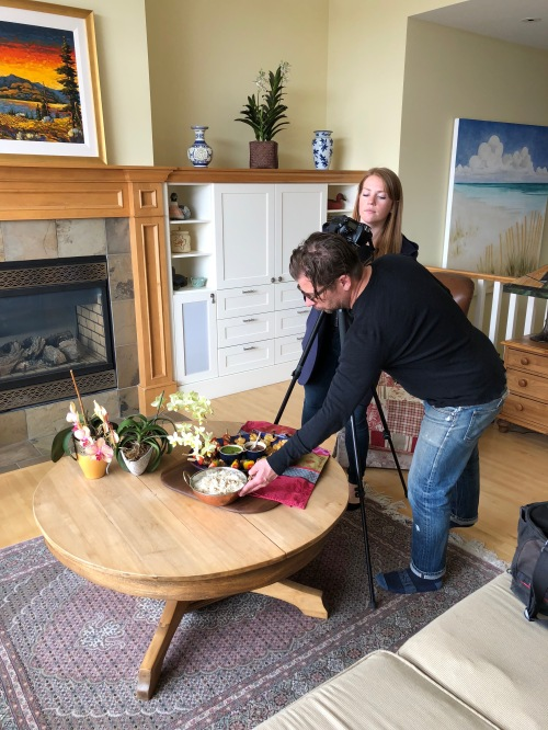 Avenue Magazine photographer and art director, Jared Sych and Sarah McMenemy setting up for a photoshoot in the home of Savour It All author Karen Anderson