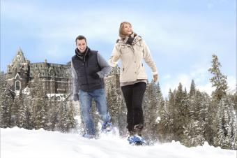 snowshoers outside of the Fairmont Banff Springs Hotel