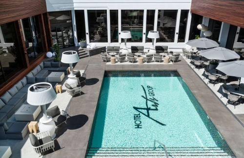 a view of the pool and furniture at Poolside by Hotel Arts in Calgary